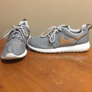 cc41d62985a1 Nike Shoes - Nike women s Roshe Run Grey w  Gold Swoosh
